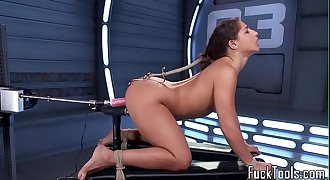 Restrained honey pussy toyed by dildo machine